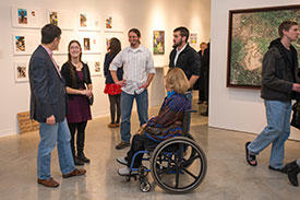 Mason students attend an art gallery show opening